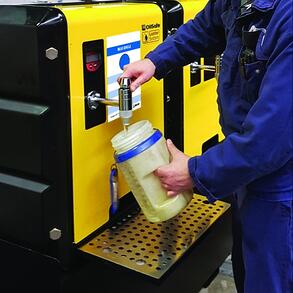 Oil Storage and Organization. Person pours oil into a sample tester for testing oil purity