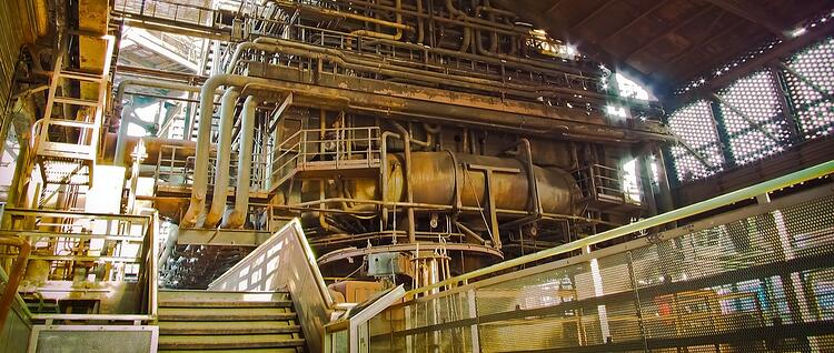 Conserving oil and grease in a steel mill
